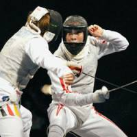 Great accomplishment: Fencer Yuki Ota (right), who earned a silver medal in the men's foil competition in the 2008 Beijing Olympics, is now No. 1 in the world rankings. | KYODO PHOTO
