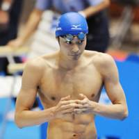 Make it double: Ryosuke Irie wins the men's 200-meter backstroke on Saturday at Tokyo Tatsumi International Swimming Center. This is his second victory at the ongoing Japan Open following Friday's 100 backstroke. | KYODO PHOTO