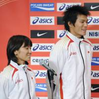 Leaving for Berlin: Track and field athletes Daichi Sawano (right) and Satomi Kubokura vow their determination for the upcoming world championships at Berlin during a press conference in Tokyo on Wednesday. | KYODO PHOTO