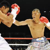 Impressive display: Former WBA light flyweight champion Koki Kameda (right) lands a punch against Mexican opponent Humberto Pool in Saturday's non-title bout at Differ Ariake. Kameda knocked out Pool three times in the fifth-round before the referee stopped the fight. | KYODO PHOTO