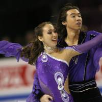 Out in the cold: Ice dancers Cathy and Chris Reed have qualified to represent Japan in the 2010 Vancouver Olympics, but their mother says they are not receiving the financial backing they need from the Japan Skating Federation. | AP PHOTO