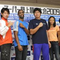Elite field: Track and field stars, including American sprinter Tyson Gay (third from left) are scheduled to compete in the 2009 Super Track and Field Meet on Wednesday in Kawasaki.   KYODO PHOTO