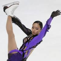 Poised for podium: Miki Ando competes during the short program at the Rostelecom Cup in Moscow on Friday night. Ando is third heading into the free skate. | KYODO PHOTO