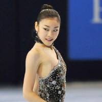 Goldfinger: World champion Kim Yu Na is the favorite to win this week's Grand Prix Final in Tokyo.   KYODO PHOTO