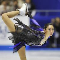 Strong start: Miki Ando earns a season-best 66.20 points in the short program on Friday in the Grand Prix Final. | KYODO PHOTO