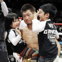 Proud papa: Hozumi Hasegawa, the WBC bantamweight champion, is congratulated by his children after his 10th title defense on Friday night. | KYODO PHOTO