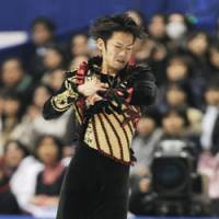 Strong effort: Daisuke Takahashi performs during the men's short program at the Japan National Figure Skating Championships on Friday in Osaka. Takahashi leads the field with 92.85 points. | KYODO PHOTO