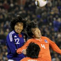 No holds barred: Japan's 3-1 defeat to South Korea last weekend was not pretty but at least it was competitive.   KYODO PHOTO