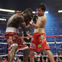 Fight night: Manny Pacquiao has vanquished all comers during his recent rise into the ranks of boxing's elite. | AP PHOTO