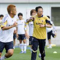 Loose tongue: National team manager Takeshi Okada appeared to offer his resignation after Monday's defeat to South Korea, only to backtrack on his comments a day later. | KYODO PHOTO