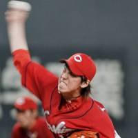 Catch of the day: Carp pitcher Kenta Maeda is among Japan's top pitchers this season. | KYODO PHOTO