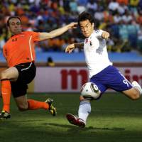 Tight fit: Shinji Okazaki could not add to Japan's one goal scored at the 2010 World Cup after coming on as a substitute against the Netherlands on Saturday. | AP PHOTO