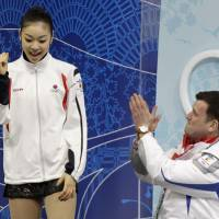 Nothing lasts forever: Olympic champion Kim Yu Na and Brian Orser, seen here after the short program at the Vancouver Games, have endured an acrimonious split.   AP PHOTO
