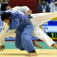 Big-time throw: Greece's Ilias Iliadis defeats Japan's Daiki Nishiyama by ippon to capture the gold medal in the men's 90 kg of the World Judo Championships at Yoyogi National Gymnasium on Friday. | KYODO PHOTO