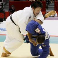 Gold standard: Daiki Kamikawa throws France's Teddy Riner in the men's open class final at the world judo championships on Monday.   KYODO PHOTO