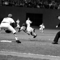 No holding back: Cincinnati Reds star Pete Rose dives headfirst into third base in the ninth inning of Game 7 of the 1975 World Series against the Boston Red Sox. | AP PHOTO