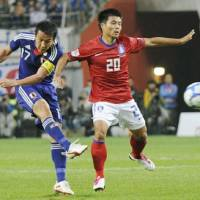 Center of attention: National team captain Makoto Hasebe has helped new manager Alberto Zaccheroni get his reign off to an impressive start. | KYODO PHOTO