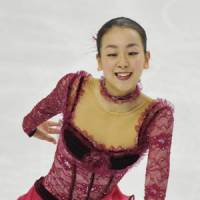 New season begins: Mao Asada and fellow world champions Daisuke Takahashi, Kanako Murakami and Yuzuru Hanyu will compete at the NHK Trophy in Nagoya starting Friday. | KYODO PHOTO