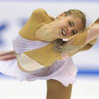 Off to a good start: Italy's Caroline Kostner performs her free skate program at the NHK Trophy on Saturday in Nagoya. Kostner claimed victory in the season's first Grand Prix. | KYODO PHOTO