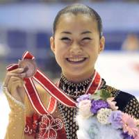 Brilliant debut: Kanako Murakami displays her bronze medal after finishing third in her first senior tournament at the NHK Trophy at Nippon Gaishi Arena in Nagoya on Saturday. | KYODO PHOTO