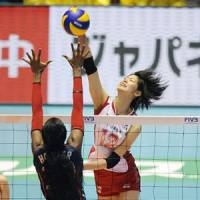 Get higher: Saori Kimura fires a spike against the United States during their third-place match on Sunday. | KYODO PHOTO