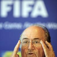 Eye of the storm: FIFA president Sepp Blatter will oversee the voting for the 2018 and 2022 World Cup hosting rights on Thursday in Zurich. | AP PHOTO