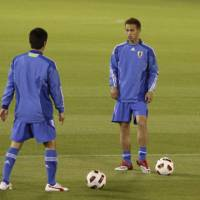 Ready for action: Keisuke Honda (right) will be a key figure in Japan's Asian Cup challenge in Qatar over the coming month. | AP PHOTO