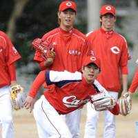 Building for tomorrow: Carp fans hope pitchers Yuya Fukui, front, Yuki Saito, center, and Kenta Maeda can help get things turned around in Hiroshima. | KYODO PHOTO