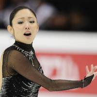 One step higher: Miki Ando performs her free program at the Four Continents in Taipei on Sunday. Ando won with a personal best of 134.76 points. | KYODO PHOTO