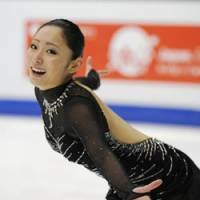 Miki Ando performs her free program en route to victory at the Four Continents in Taipei on Sunday. Ando's score of 201.34 — a personal best — gave her the edge over runnerup Mao Asada and third-place American Mirai Nagasu. | KYODO PHOTO