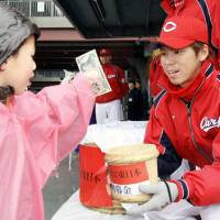 Doing the right thing: Baseball stars such as Kenta Maeda of the Hiroshima Carp collected donations to aid relief efforts and urged the CL to delay its season openers. | KYODO PHOTO