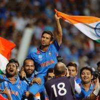 Job well done: Sachin Tendulkar and title-winning India led a strong contingent of Asian teams at the 2011 Cricket World Cup. | AP PHOTO