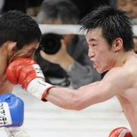 Powerful punch: Toshiaki Nishioka lands a left hand against Argentina's Mauricio Munoz in the first round of their WBC super bantamweight title bout on Friday. | KYODO PHOTO