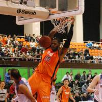 Easy deuce: Brandon Cole throws down a slam dunk earlier this season against the Rizing Fukuoka. | MIYAZAKI SHINING SUNS / BJ-LEAGUE
