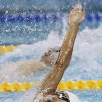 Full speed ahead: Ryosuke Irie competes in the men's 100-meter backstroke final at the 2011 FINA World Swimming Championships on Tuesday in Shanghai. Irie captured the bronze medal in a time of 52.98 seconds. | KYODO