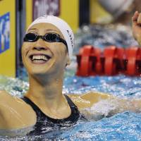Euphoria: Aya Terakawa reacts after capturing the silver medal in the women's 50-meter backstroke final at the 2011 FINA World Swimming Championships on Thursday in Shanghai. | KYODO PHOTO