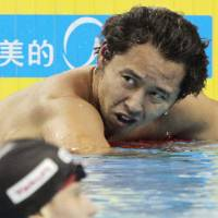 Disappointment: Kosuke Kitajima reacts after finishing second in the men's 200-meter breaststroke final on Friday in Shanghai. | KYODO PHOTOS