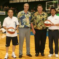 Ties that bind: Yoshinori Shimizu (Panasonic Trians head coach), Gib Arnold (University of Hawaii men's basketball head coach), Jim Donovan (UH athletic director) and Nobuhiro Hagiwara (Panasonic club director) pose for a picture in Osaka. | KAZ NAGATSUKA