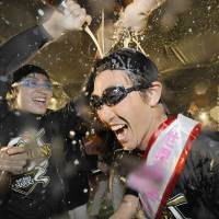 Keep the party going: Seiichi Uchikawa and the Fukuoka Softbank Hawks want to hold another celebration in November after the Japan Series. | KYODO PHOTO