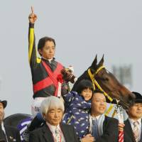 Number 1: Jockey Yasunari Iwata celebrates victory atop Buena Vista at the Japan Cup in Tokyo on Sunday. | KYODO