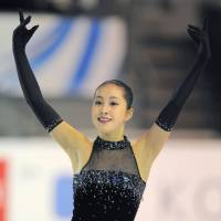 Medal contender: Risa Shoji competes in the short program at the Grand Prix Final on Thursday. Shoji is in fourth place heading into Friday's free skate. | KYODO