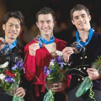 Final countdown: Gold medalist Patrick Chan (center) poses with silver medalist Daisuke Takahashi (left) and bronze medalist Javier Fernandez after the Grand Prix Final on Saturday in Quebec City. | AP PHOTO