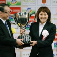 Team of the year: Forward Karina Maruyama accepts the Japan Pro Sports Grand Prize for the women's national soccer team at the Japan Sports Awards ceremony in Tokyo on Tuesday. | KYODO