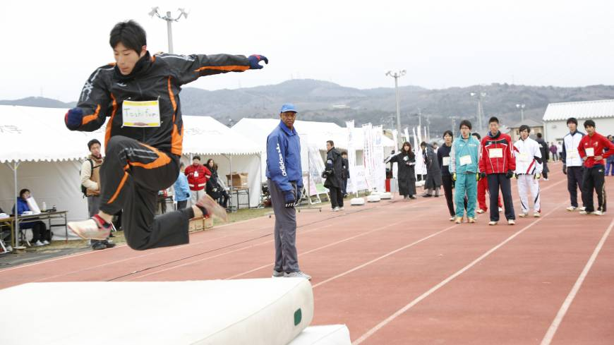 A watchful eye: Willie Banks, a former world triple jump record holder, observes students practicing over the weekend.