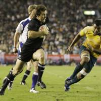 Pay dirt: New Zealand's Conrad Smith scores a try against Australia during their Bledisloe Cup match at National Stadium on Saturday. The All Blacks defeated the Wallabies 32-19. | AP PHOTO