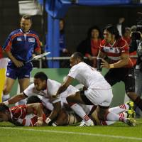 Down and dirty: Japan openside flanker Michael Leitch scores a try for the Brave Blossoms against Tonga during the first half of  their clash at the Rugby World Cup on Wednesday. Tonga won 31-18.   AKI NAGAO