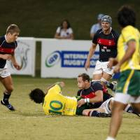 Down and dirty: Hong Kong and Brazil compete during the final of the inaugural Emirates Airlines Cup of Nations on Friday in Dubai. | UNITED ARAB EMIRATES RUGBY FOOTBALL UNION