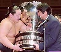 Yokozuna Asashoryu receives the Emperor's Cup from newly appointed Liberal Democratic Party Secretary General Shinzo Abe after winning the Autumn Basho.
