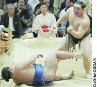 Yokozuna Asashoryu reacts after pushing out ozeki Tochiazuma on the final day of the Nagoya Grand Sumo Tournament at Aichi prefectural gymnasium to capture his fifth consecutive Emperor's Cup.