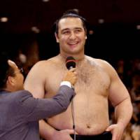 Pride of Bulgaria: 25-year-old European-born rikishi Kotooshu has a few words for the fans May 25 after winning the Summer Grand Sumo Tournament at Ryogoku Kokugikan, Tokyo. | KYODO PHOTOS